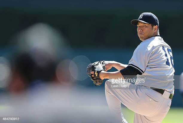 Hiroki Kuroda of the New York Yankees warms up prior to the start oif the first inning of the game against the Detroit Tigers at Comerica Park on...