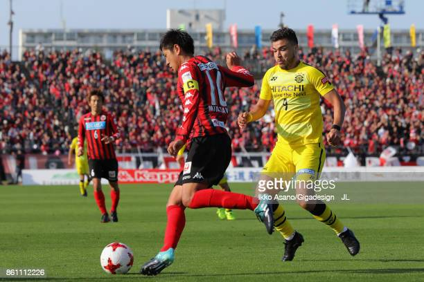 Hiroki Miyazawa of Consadole Sapporo and Cristiano of Kashiwa Reysol compete for the ball during the JLeague J1 match between Consadole Sapporo and...
