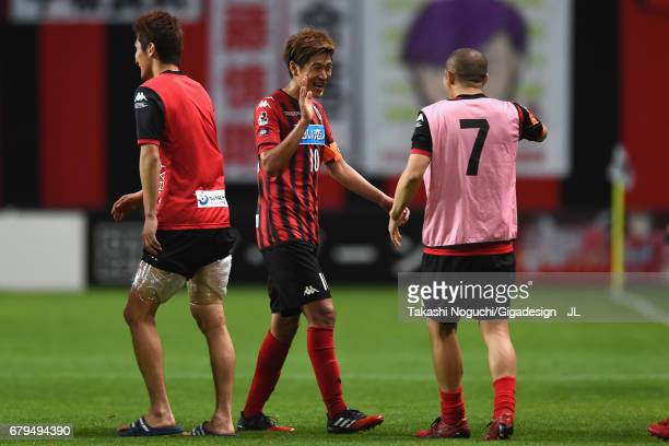 Hiroki Miyazawa of Consadole Sapporo high fives with Shinji Ono after their 10 victory in the JLeague J1 match between Consadole Sapporo and Omiya...
