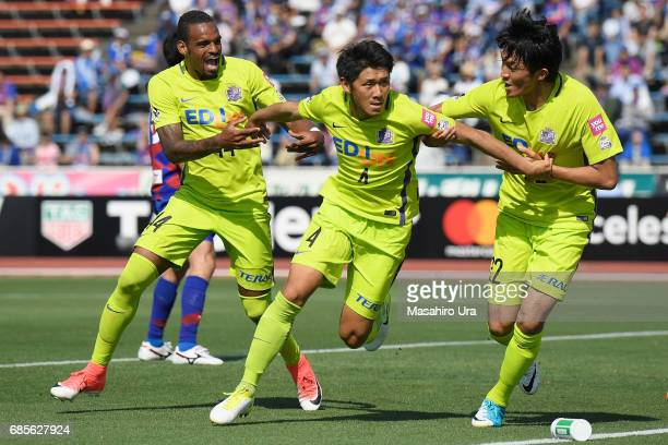 Hiroki Mizumoto of Sanfrecce Hiroshima celebrates scoring his side's second goal with team mates during the JLeague J1 match between Ventforet Kofu...