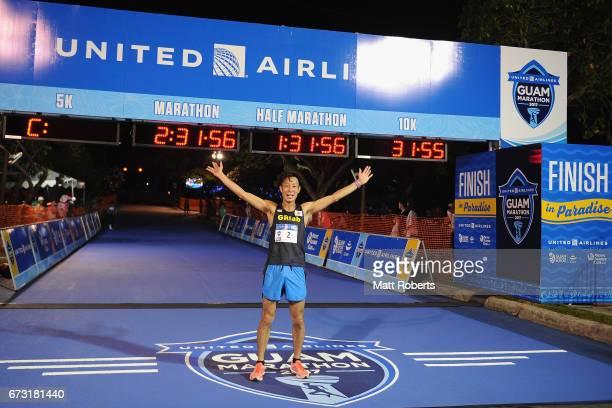 Hiroki Nakajima of Japan celebrates winning the United Airlines Guam Marathon 2017 in a time of 23033 on April 9 2017 in Guam Guam Hiroki Nakajima...