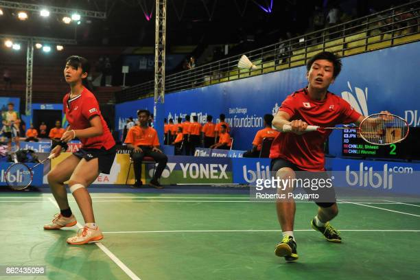 Hiroki Nakayama and Moe Yamaguchi of Japan compete against Liu Shiwen and Li Wenmei of China during Mixed Double qualification round of the BWF World...