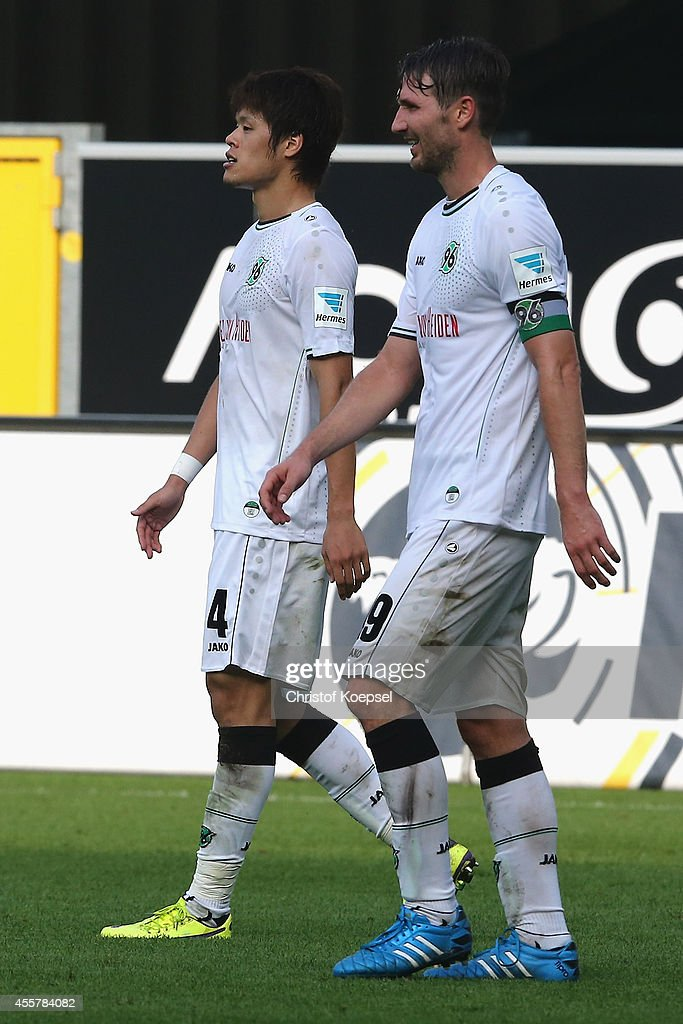Hiroki Sakai and Christian Schulz of Hannover look dejected after losing the Bundesliga match between SC Paderborn and Hannover 96 at Benteler Arena...