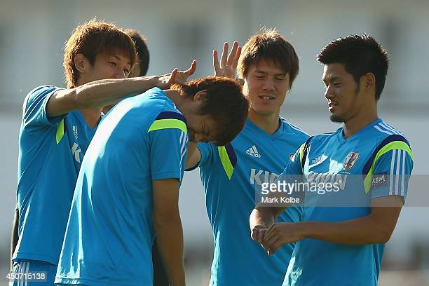 Hiroki Sakai is flicked by team mates after losing a game during warmup for a Japan training session at the Japan national team base camp at the Spa...