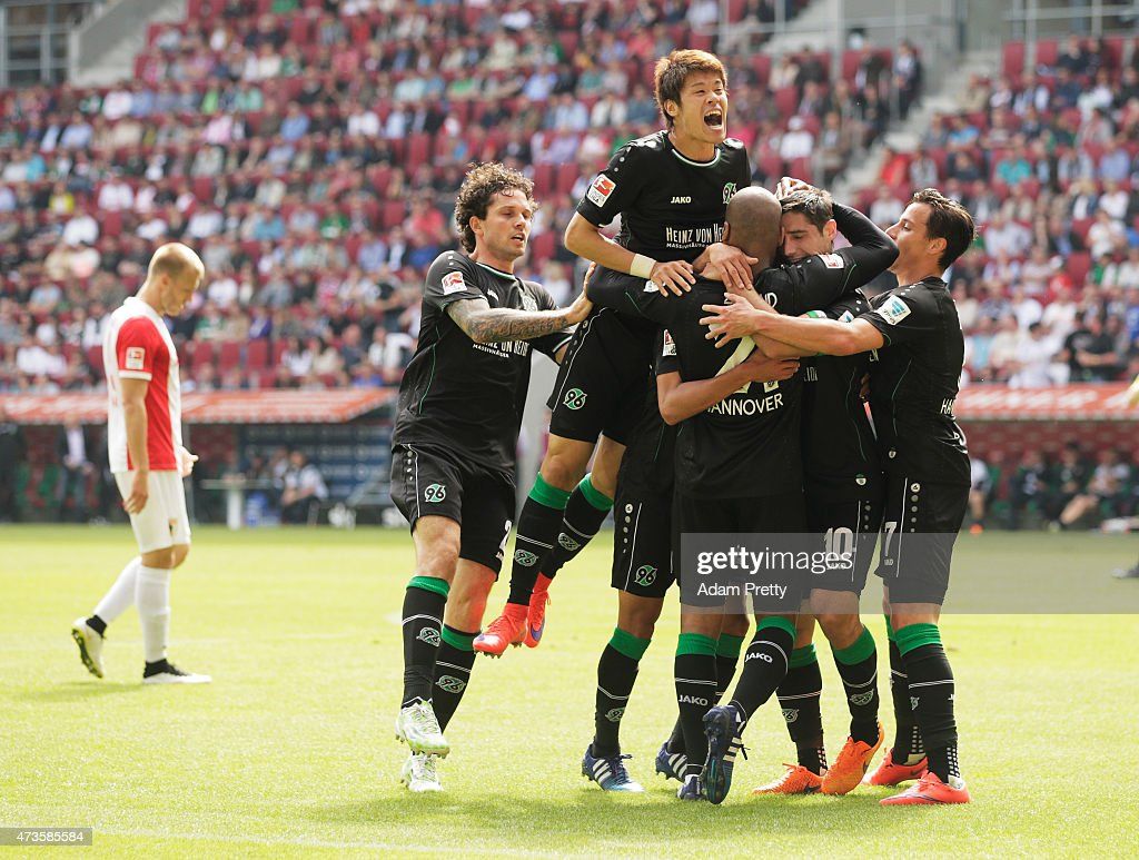 Hiroki Sakai of Hannover 96 congratulates Lars Stindl after he scored the first goal during the Bundesliga match between FC Augsburg and Hannover 96...