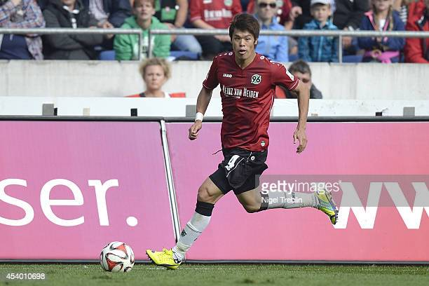 Hiroki Sakai of Hannover controls the ball during the Bundesliga match between FC Schalke 04 and Hannover 96 at HDIArena on August 23 2014 in Hanover...