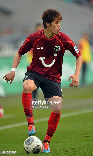 Hiroki Sakai of Hannover in action during the Bundesliga match between Hannover 96 and Werder Bremen at HDIArena on March 23 2014 in Hanover Germany