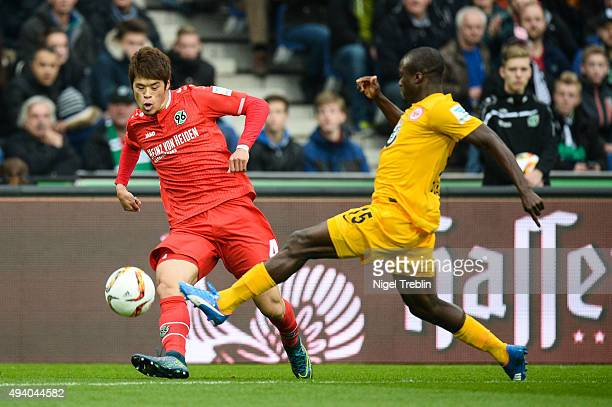 Hiroki Sakai of Hannover is challenged by Constant Djakpa of Frankfurt during the Bundesliga match between Hannover 96 and Eintracht Frankfurt at...