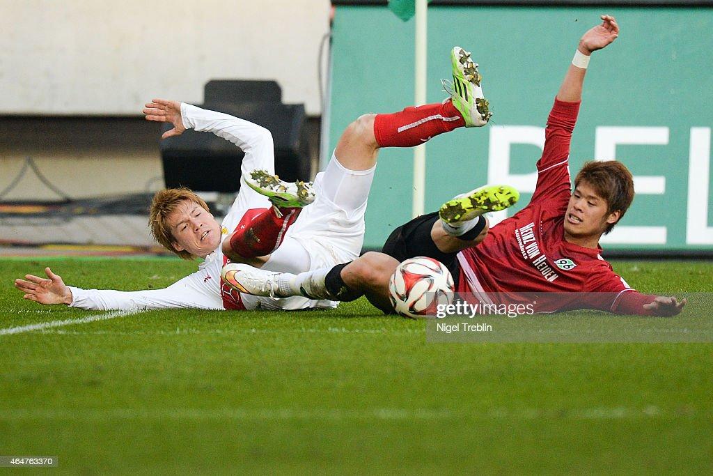 Hiroki Sakai of Hannover is challenged by Gotoku Sakai of Stuttgart during to the Bundesliga match between Hannover 96 and VfB Stuttgart at HDIArena...
