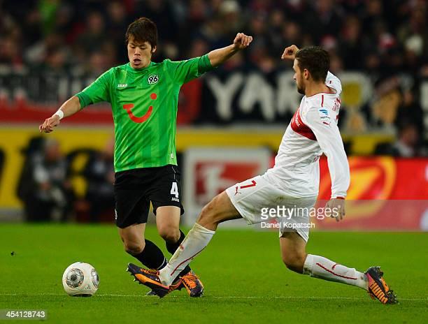 Hiroki Sakai of Hannover is challenged by Martin Harnik of Stuttgart during the Bundesliga match between VfB Stuttgart and Hannover 96 at...