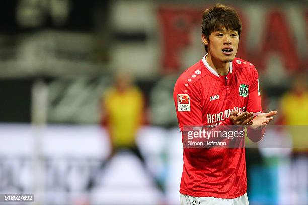Hiroki Sakai of Hannover reacts during the Bundesliga match between Eintracht Frankfurt and Hannover 96 at CommerzbankArena on March 19 2016 in...