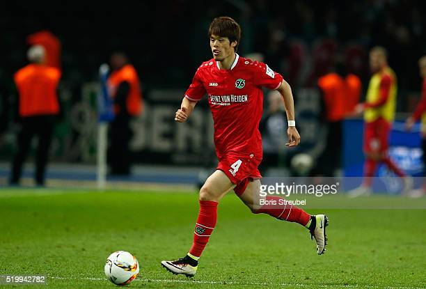 Hiroki Sakai of Hannover runs with the ball during the Bundesliga match between Hertha BSC and Hannover 96 at Olympiastadion on April 8 2016 in...