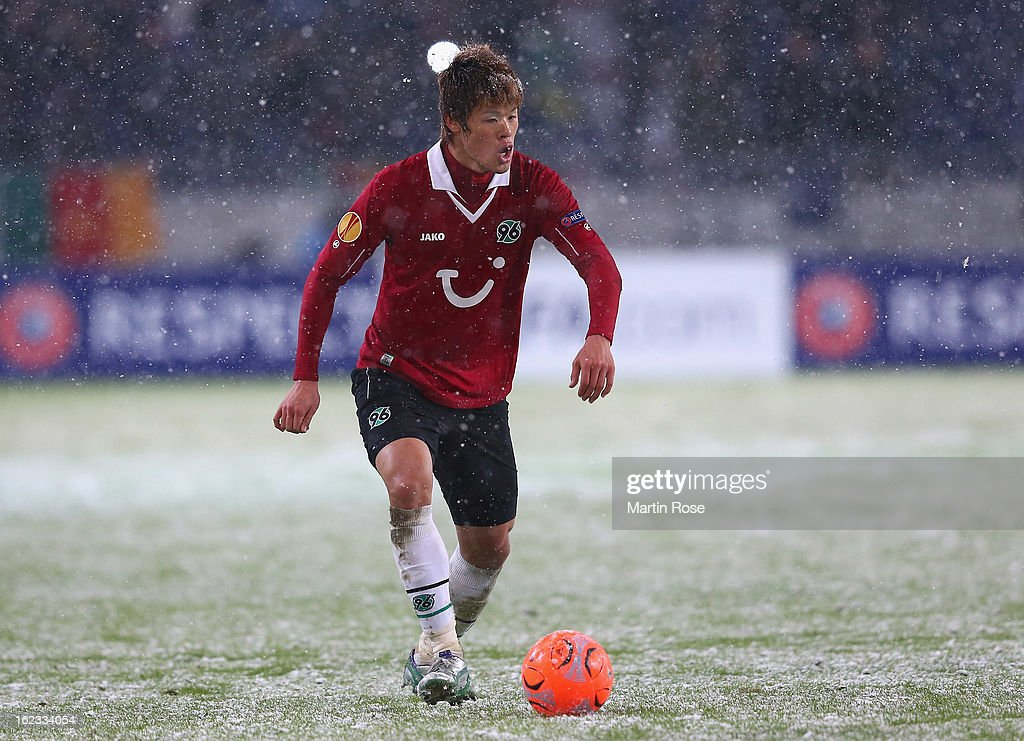 Hiroki Sakai of Hannover runs with the ball during the UEFA Europa League Round of 32 second leg match between Hannover 96 and Anji Makhachkala at AWD Arena on February 21, 2013 in Hannover, Germany.