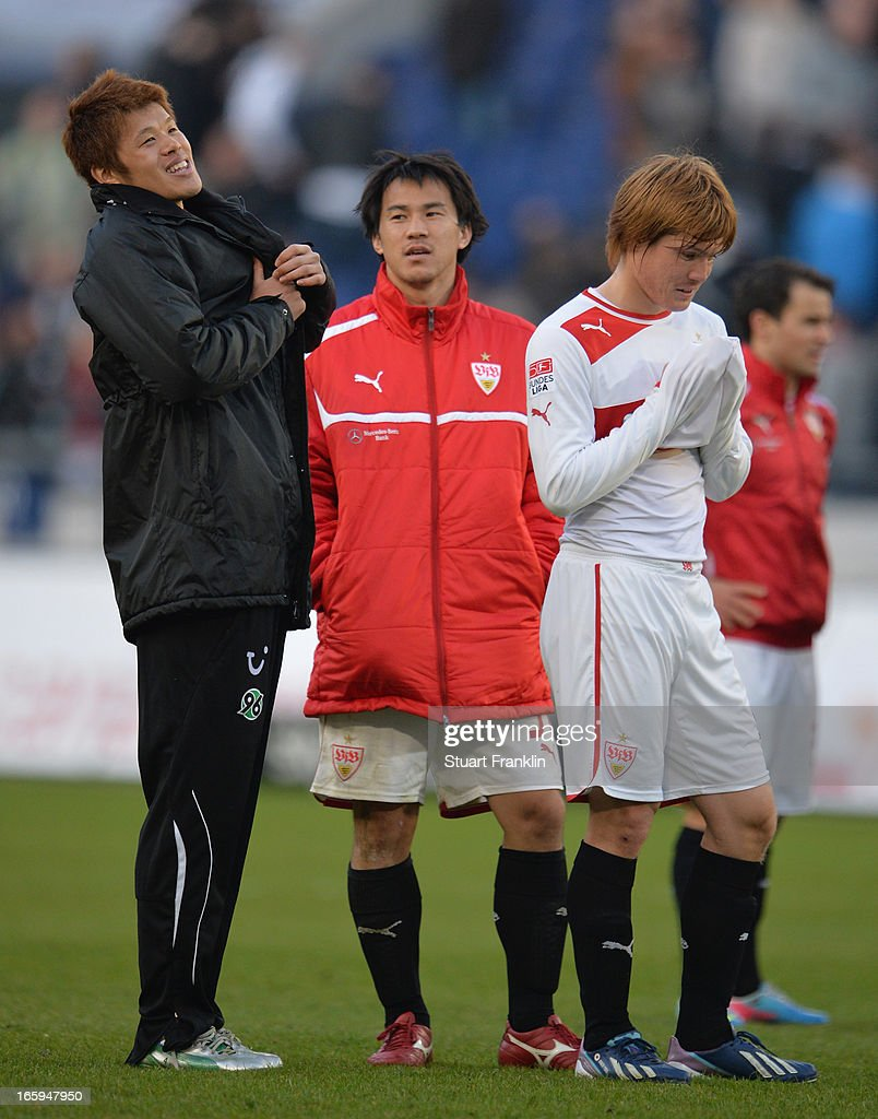 Hiroki Sakai of Hannover talks with Shinji Okazaki and Gotoku Sakai of Stuttgart at the end of the Bundesliga match between Hannover 96 v VfB Stuttgart at AWD Arena on April 7, 2013 in Hannover, Germany.