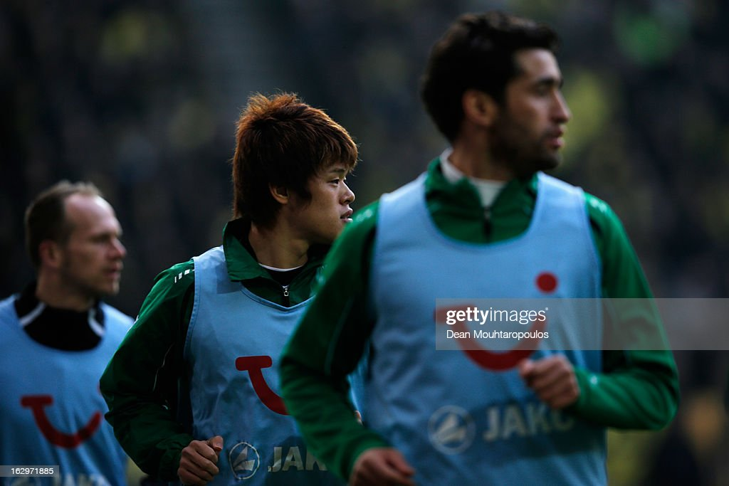 <a gi-track='captionPersonalityLinkClicked' href=/galleries/search?phrase=Hiroki+Sakai&family=editorial&specificpeople=7728461 ng-click='$event.stopPropagation()'>Hiroki Sakai</a> (C) of Hannover warms up on the sidelines during the Bundesliga match between Borussia Dortmund and Hannover 96 at Signal Iduna Park on March 2, 2013 in Dortmund, Germany.