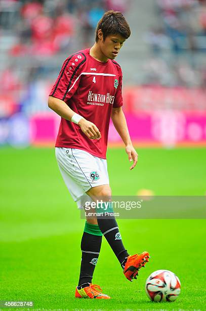 Hiroki Sakai of Hannover warms up prior to the Bundesliga match between FC Bayern Muenchen and Hannover 96 at Allianz Arena on October 4 2014 in...
