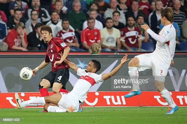 Hiroki Sakai of Hanover is challenged by Daniel Didavi of Stuttgart during the Bundesliga match between Hannover 96 and VfB Stuttgart at HDIArena on...