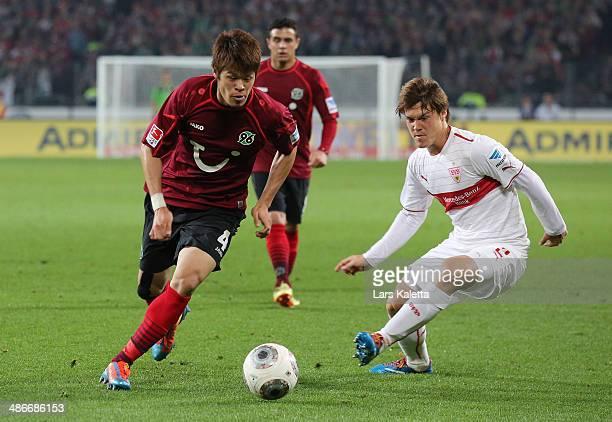Hiroki Sakai of Hanover runs for the ball with Gotoku Sakai of Stuttgart during the Bundesliga match between Hannover 96 and VfB Stuttgart at...