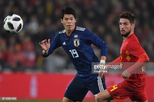 Hiroki Sakai of Japan and Dries Mertens of Belgium compete for the ball during the international friendly match between Belgium and Japan at Jan...