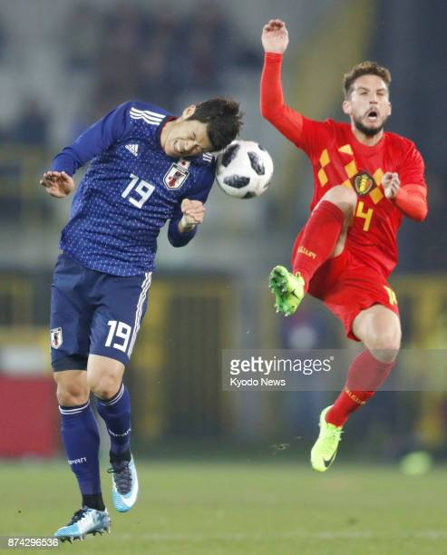 Hiroki Sakai of Japan and Dries Mertens of Belgium vie for the ball during the first half of a soccer friendly in Bruges Belgium on Nov 14 2017...