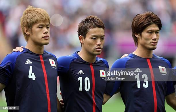 Hiroki Sakai of Japan Keigo Higashi of Japan and Daisuke Suzuki of Japan look on during the Men's Football Semi Final match between Mexico and Japan...