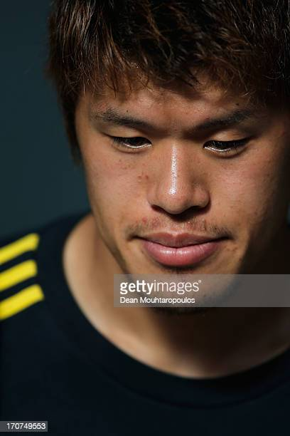 Hiroki Sakai of Japan speaks to the media after the Japan Training Session at the Confederations Cup 2013 at Centro de Capacitacao Fisica dos...