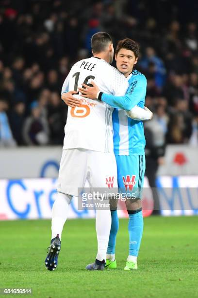 Hiroki Sakai of Marseille embraces Yohann Pele of Marseille after the Ligue 1 match between Lille OSC and Olympique de Marseille at Stade Pierre...