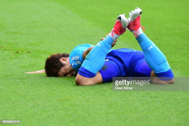 Hiroki Sakai of Marseille goes down injured during the Ligue 1 match between FC Nantes and Olympique Marseille at Stade de la Beaujoire on August 12...