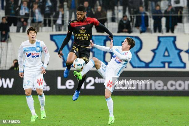 Hiroki Sakai of Marseille Marcus Coco of Guingamp and Maxime Lopez of Marseille during the French Ligue 1 match between Marseille and Guingamp at...