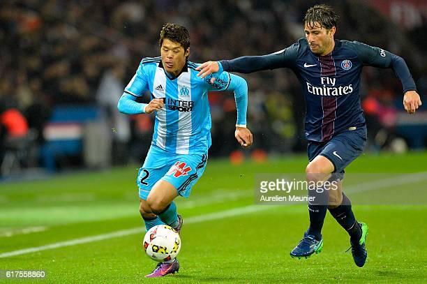 Hiroki Sakai of Olympique de Marseille and Maxwell of Paris SaintGermain fight for the ball during the Ligue 1 match between Paris SaintGermain and...