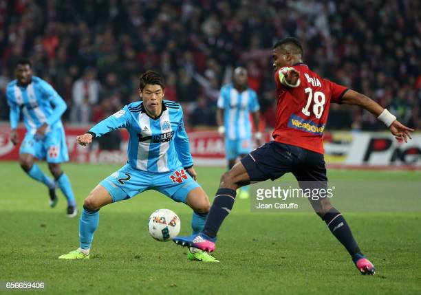Hiroki Sakai of OM and Franck Beria of Lille in action during the French Ligue 1 match between Lille OSC and Olympique de Marseille at Stade...