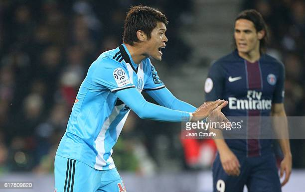 Hiroki Sakai of OM motivates his teammates while Edinson Cavani of PSG looks on during the French Ligue 1 match between Paris SaintGermain PSG and...