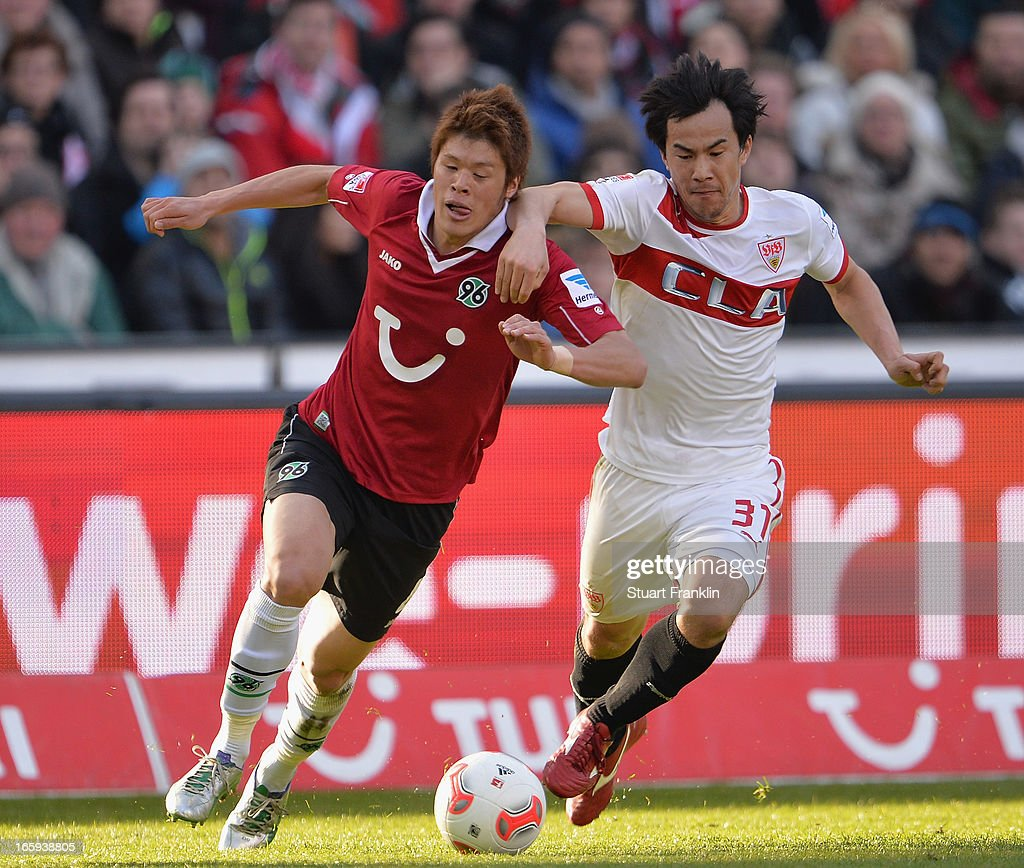Hiroki Sakaii of Hannover is challenged by Shinji Okazaki of Stuttgart during the Bundesliga match between Hannover 96 v VfB Stuttgart at AWD Arena on April 7, 2013 in Hannover, Germany.