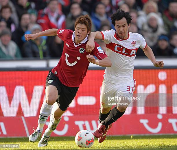 Hiroki Sakaii of Hannover is challenged by Shinji Okazaki of Stuttgart during the Bundesliga match between Hannover 96 v VfB Stuttgart at AWD Arena...