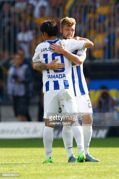 Hiroki Yamada and Yann Rolim of Karlsruhe after the Second Bundesliga match between Eintracht Braunschweig and Karlsruher SC at Eintracht Stadion on...