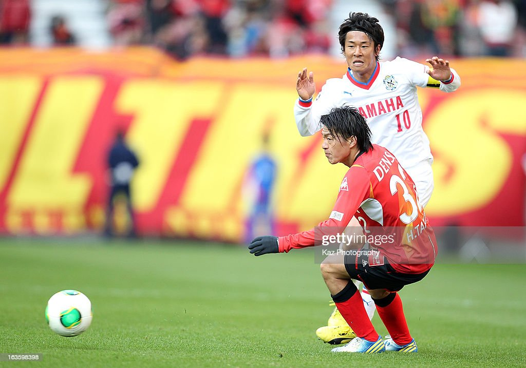 Hiroki Yamada of Jubilo Iwata and Hayuma Tanaka of Nagoya Grampus compete for the ball during the J.League match between Nagoya Grampus and Jubilo Iwata at Toyota Stadium on March 2, 2013 in Toyota, Aichi, Japan.