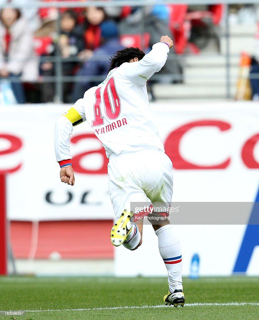 Hiroki Yamada of Jubilo Iwata celebrates scoring the first goal during the J.League match between Nagoya Grampus and Jubilo Iwata at Toyota Stadium on March 2, 2013 in Toyota, Aichi, Japan.
