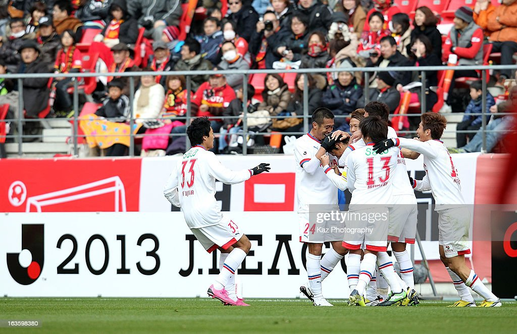 Hiroki Yamada of Jubilo Iwata is congratulated by his team mates for the first goal during the J.League match between Nagoya Grampus and Jubilo Iwata at Toyota Stadium on March 2, 2013 in Toyota, Aichi, Japan.