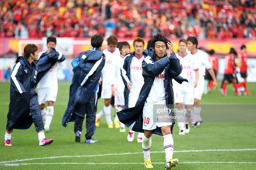 Hiroki Yamada of Jubilo Iwata waves to the supporters after the J.League match between Nagoya Grampus and Jubilo Iwata at Toyota Stadium on March 2, 2013 in Toyota, Aichi, Japan.