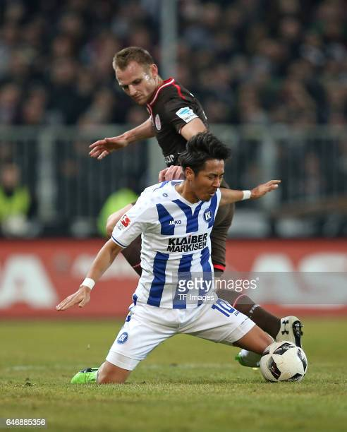 Hiroki Yamada of Karlsruhe and Bernd Nehrig of Pauli battle for the ball during the Second Bundesliga match between FC St Pauli and Karlsruher SC at...