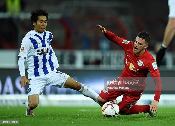 Hiroki Yamada of Karlsruhe and Diego Demme of RB Leipzig compete for the ball during the Second Bundesliga match between Karlsruher SC and RB Leipzig...