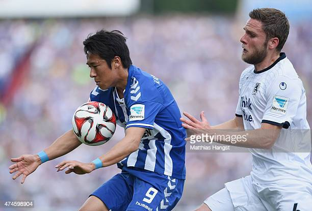 Hiroki Yamada of Karlsruhe and Dominik Stahl of 1860 Muenchen compete for the ball during the Second Bundesliga match between Karlsruher SC and 1860...