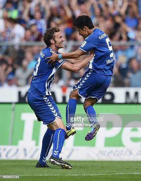 Hiroki Yamada of Karlsruhe celebrates with his teammates after scoring his team's first goal duringduring the Second Bundesliga match between...