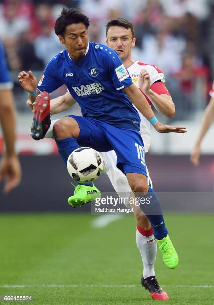 Hiroki Yamada of Karlsruhe is challenged by Christian Gentner of Stuttgart during the Second Bundesliga match between VfB Stuttgart and Karlsruher SC...