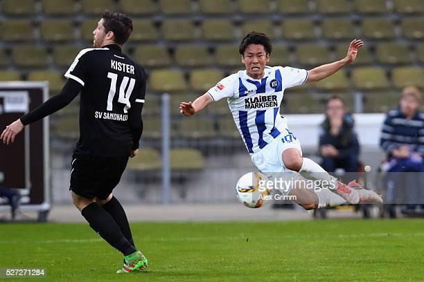 Hiroki Yamada of Karlsruhe passes the ball into there middle where team mate Dimitrios Diamantakos scores his team's third goal during the Second...