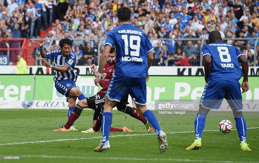 Hiroki Yamada of Karlsruhe scores his team's first goal during the Second Bundesliga match between Karlsruher SC and 1 FC Nuernberg at Wildpark...