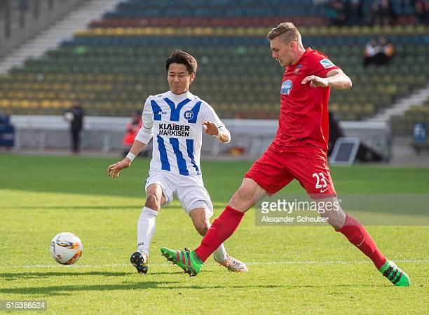 Hiroki Yamada of Karlsruher SC challenges Kevin Kraus of 1 FC Heidenheim during the second bundesliga match between Karlsruher SC and 1 FC Heidenheim...