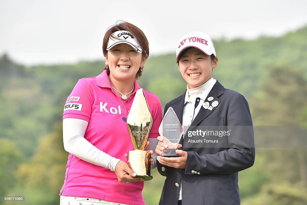 Hiroko Fukushima of Japan (L) and Suzuka Yamaguchi of Japan (R) pose with the trophy after winning the CyberAgent Ladies Golf Tournament at the Grand Fields Country Club on May 1, 2016 in Mishima, Japan.