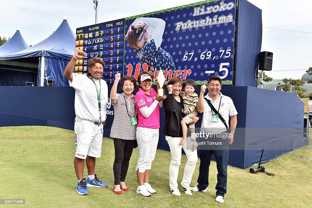 Hiroko Fukushima of Japan poses with her family after winning the CyberAgent Ladies Golf Tournament at the Grand Fields Country Club on May 1, 2016 in Mishima, Japan.