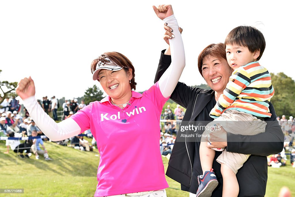 Hiroko Fukushima of Japan poses with her sister Akiko Fukushima and her nephew Kazuki Fukushima after winning the CyberAgent Ladies Golf Tournament at the Grand Fields Country Club on May 1, 2016 in Mishima, Japan.